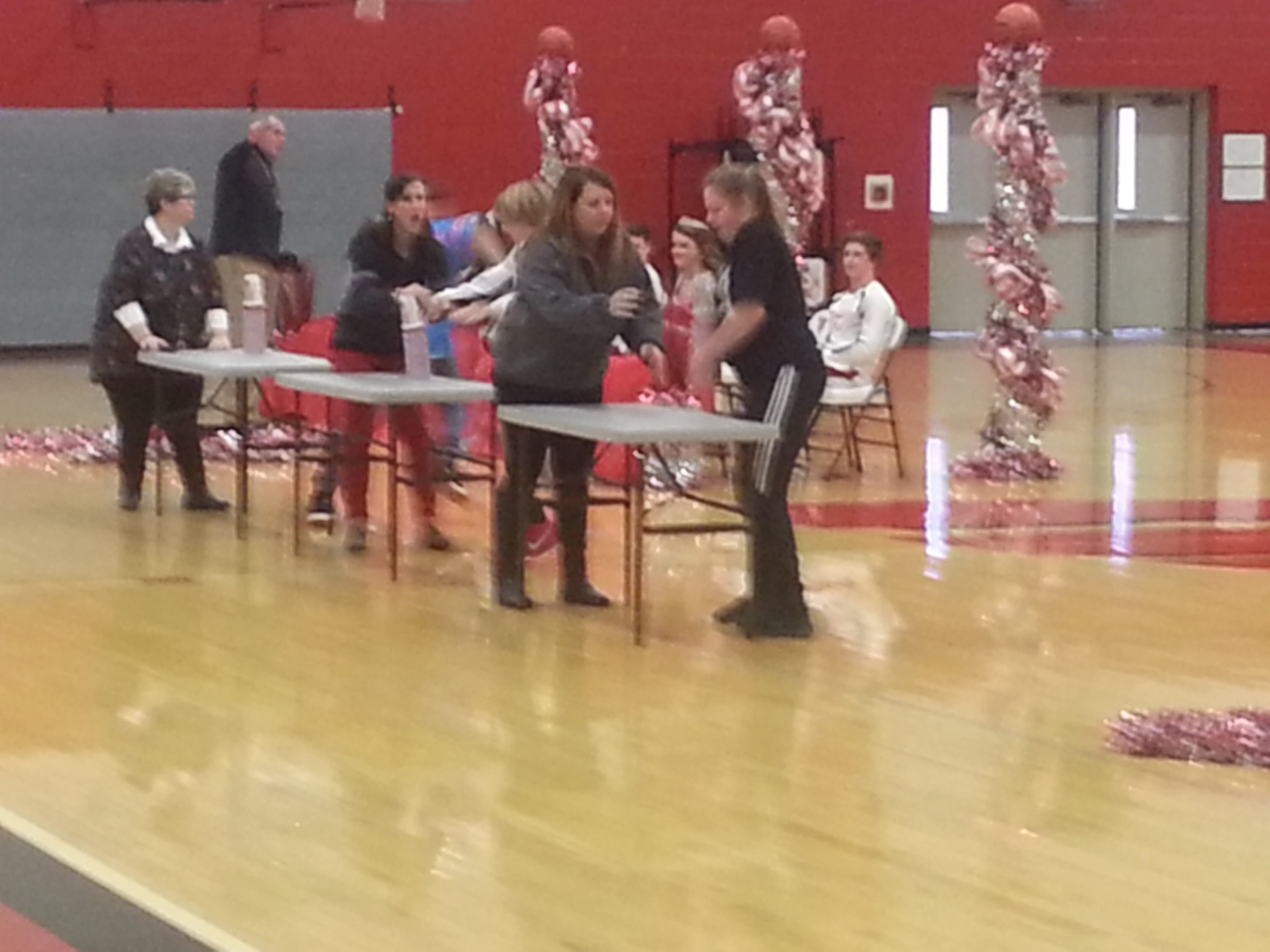Students Enjoy... participating in the Homecoming Activities.  Here each grade level is competing in a cup stacking game.  (01/08)