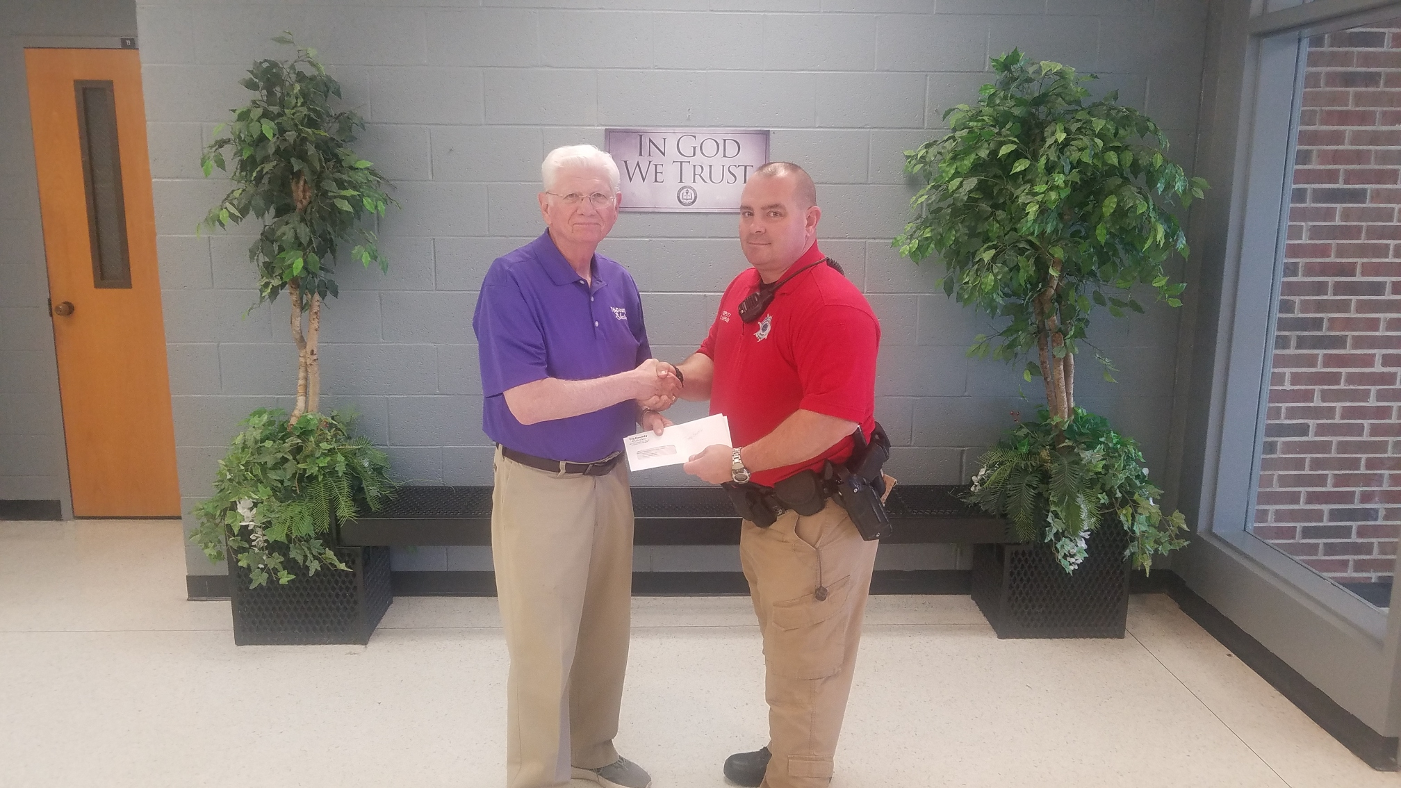 Deputy Hardin Accepts ...   a donation for the C.H.A.M.P. program from Tri-County presented by board member, Mr. Tony Bentle.  (03/22)
