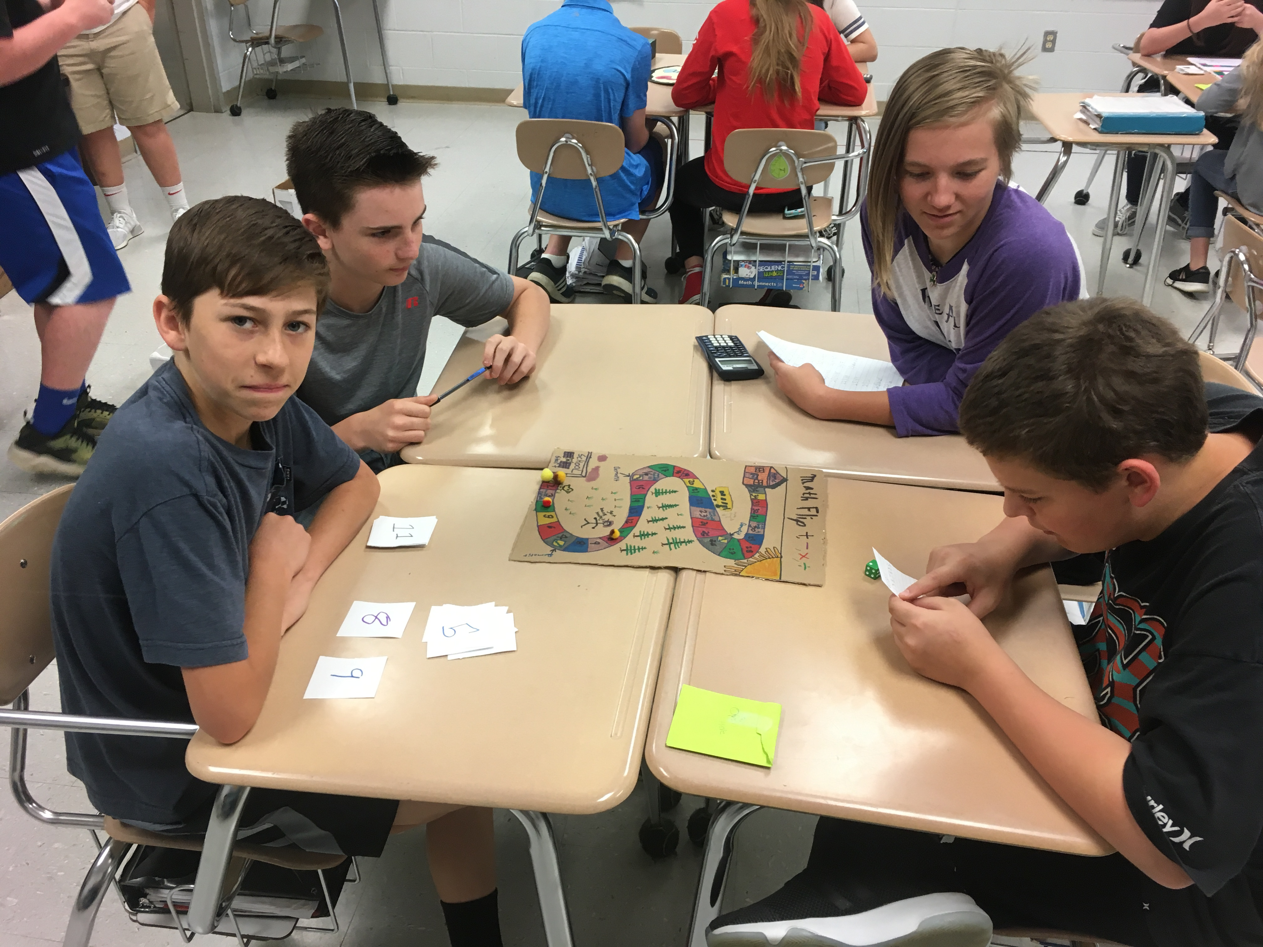 Math Students Collaboratively Create ... board games so they may see math in games.  (05/18)